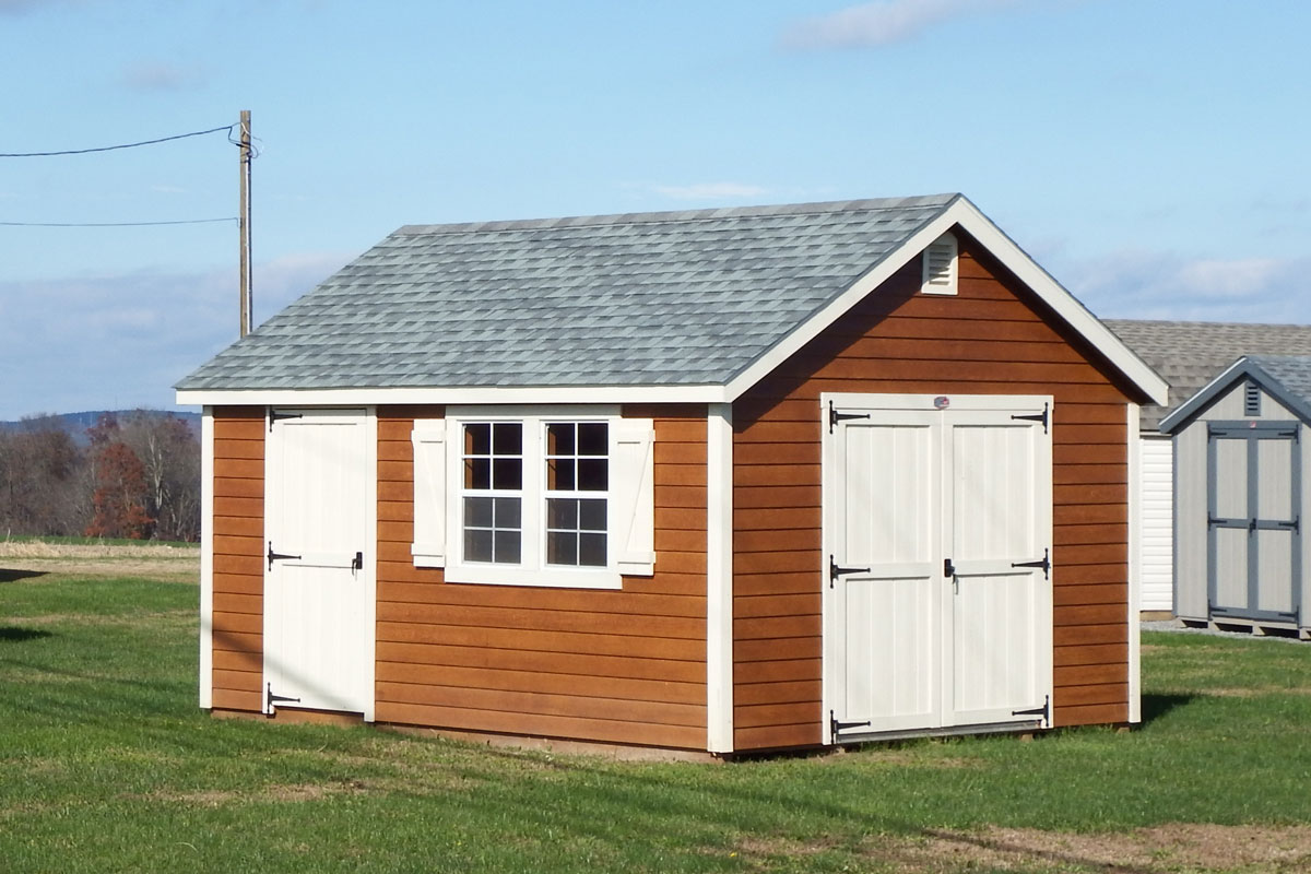 Cape Cod shed with cedar look siding