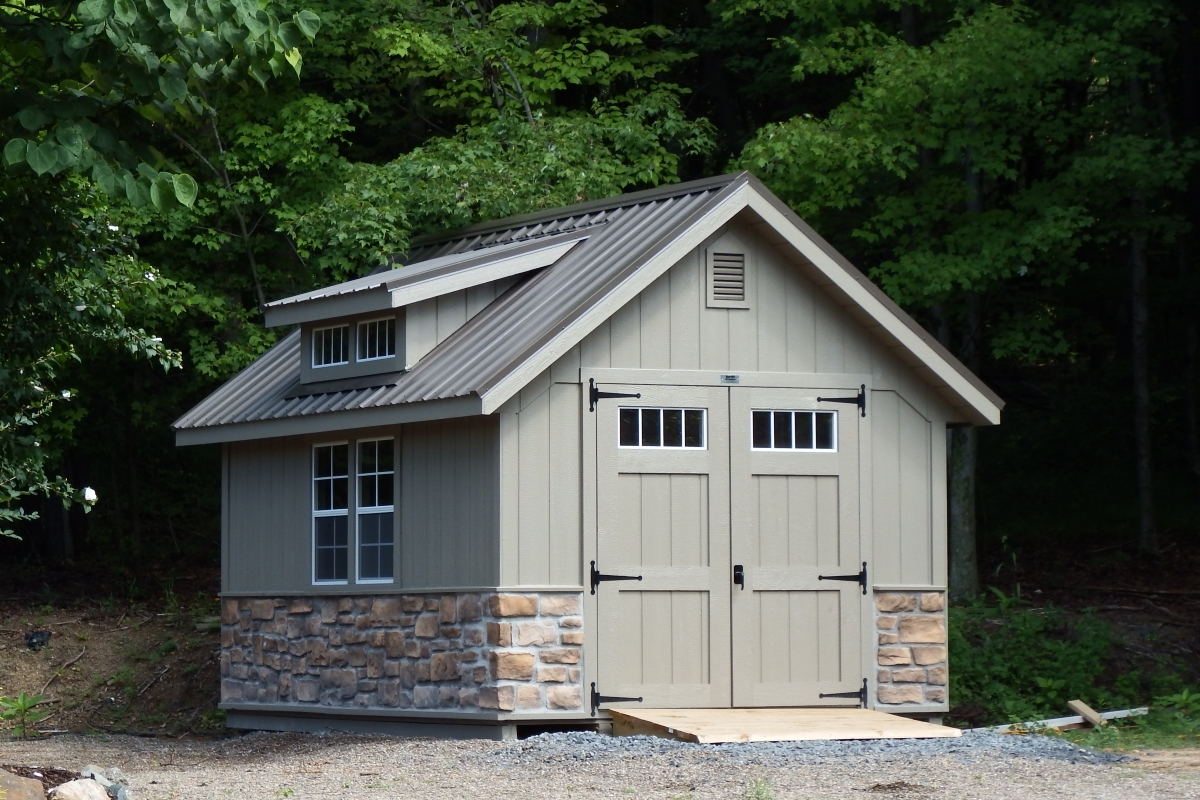 Cottage style shed with stone veneer