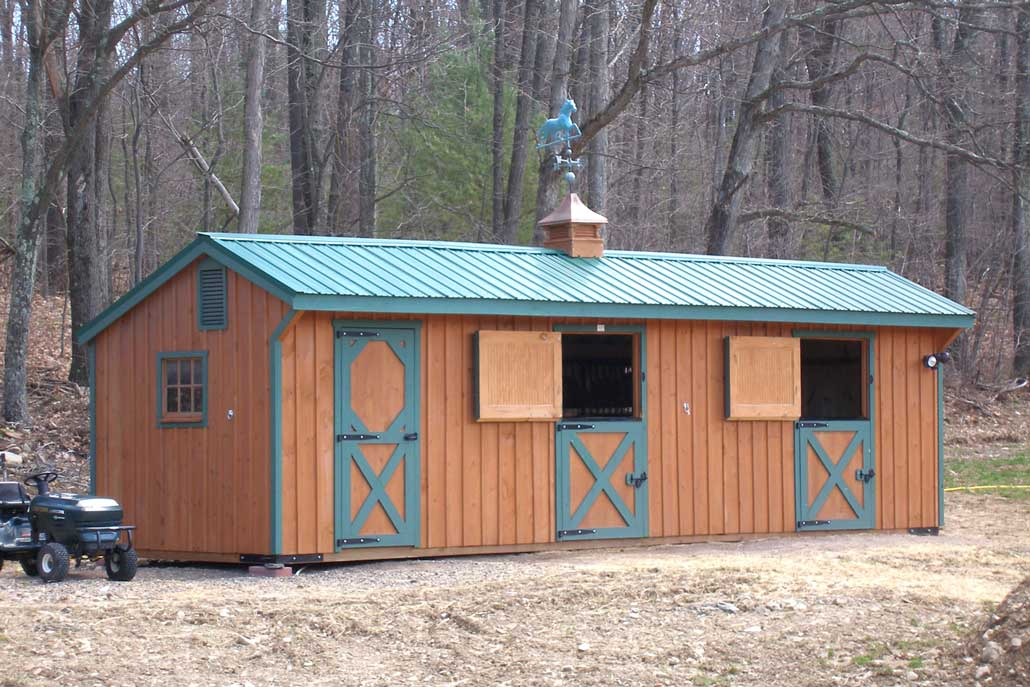 Three stall horse shed with metal roof and weathervane